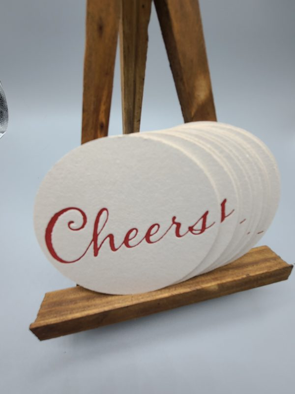 Coaster that says Cheers