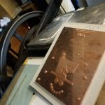 Photo shows a large copper plate that is used for foiling